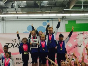 Level 3 girls team winning 1st place Team Pink Meet