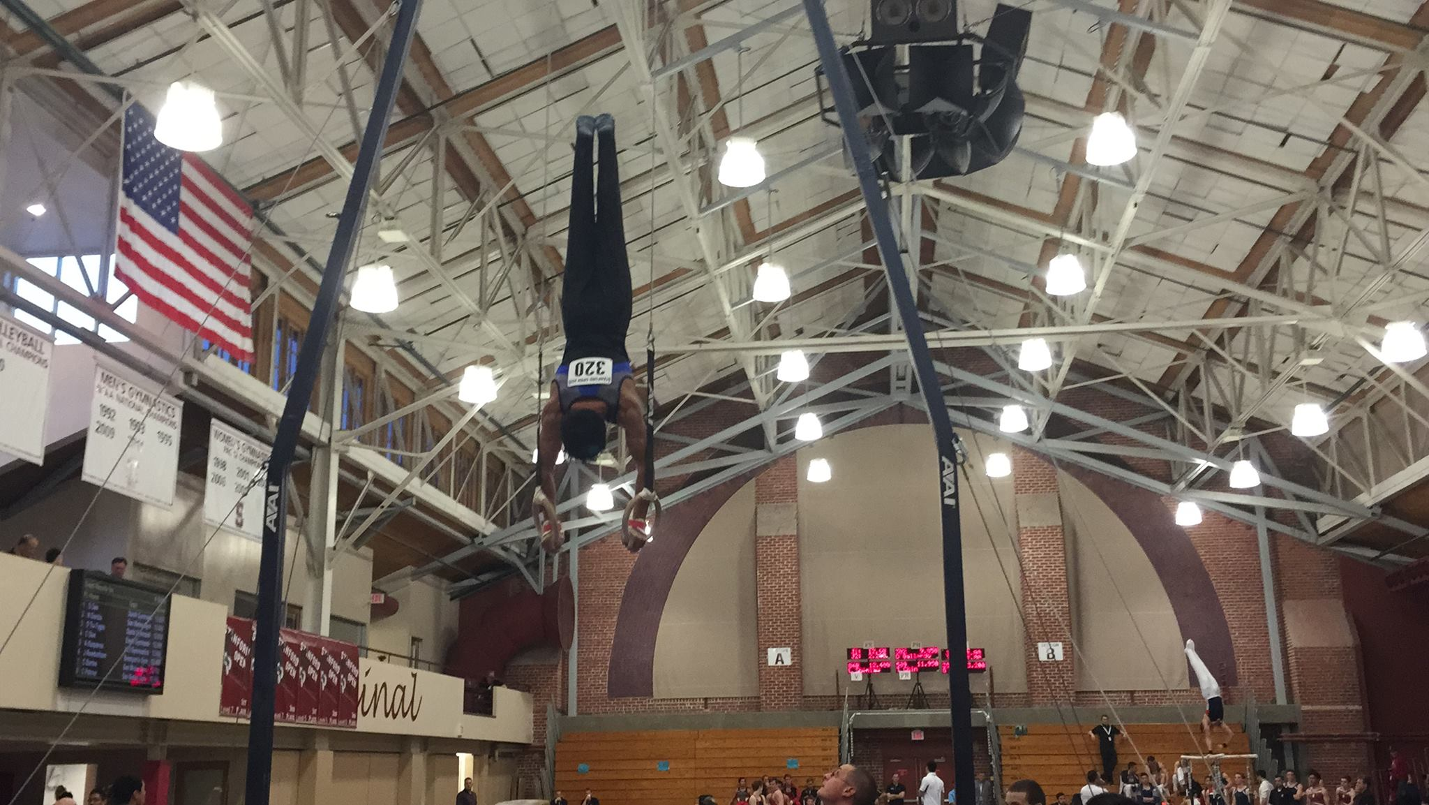 Boys opt team Caleb on the rings at Stanford